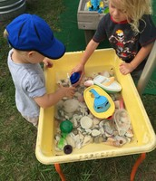 Aldous and Landon engaged in ocean life sensory table.