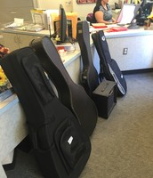 Guitars waiting in the office for Guitar Club!