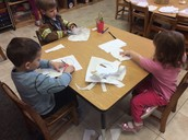 Cutting out mittens - everyone did great cutting independently!