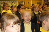 Singing and laughing in assembly