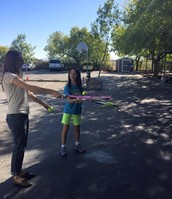 Ms. Peterson and Allison talking about racket wrist action!
