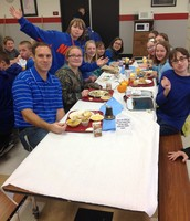 Mr. Brunson enjoying lunch with some of the 8th graders.
