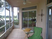 Large screened porch looking directly at the lake!