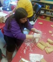 FEC Staff hard at work preparing gingerbread houses!