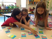 Mia, Julia, and Lillie matching short and long vowel words.