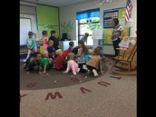 Mrs. Seidensticker's class reviewing their months of the year as they transition to math time.