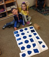 Jack and Izzy matched all the shapes in our Geometry Cabinet to the corresponding cards.