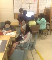 grades 4 and 5 students brainstorming ideas about identity