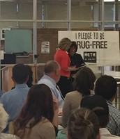 Mrs. Baker presents Mrs. Ball with her plaque