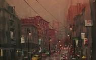 A man crosses the street in rain(1)