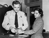 Rosa Parks being arrested