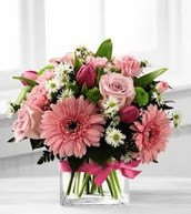Short Pink arrangment with roses, daisies and tulips