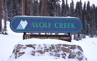 Wolf Creek sign at the front of the ski resort.