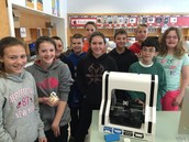 Students in Memorial School's Computer Room with a new 3D printer