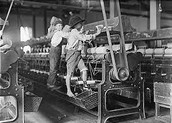 Two Children working the loom