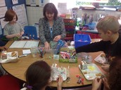 Fiona Crawshaw--at lunch--working with her students where they are buying things from their classroom incentive store.