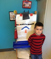 Thomas making a snowman during centers