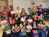 Fourth grade students are happy to have their own copy!