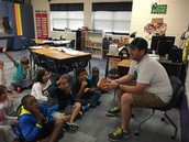 Mr. Bankhead from Adopt A Class reads to 3D