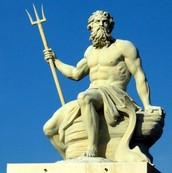 statue of Poseidon holding his trident