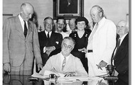 Roosevelt signing the act