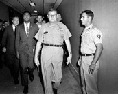 Ali being arrested for refusing to be drafted into the Vietnam War