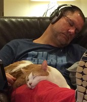 Brian taking a cat nap with Scratch.