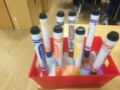 Awesome Spy #2: Tired of losing lids? Plaster and little plastic baskets make GREAT marker holders.