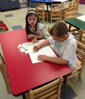 Teddy & Ayla collaborate on their sign.