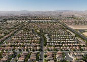 what are the main regions or areas in or nearest to north america affected by suburban sprawl?
