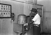 African American drinking at a African only water fountain