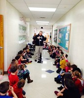 Sgt. Lewis teaching 1st grade about seat belt safety.