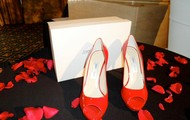 Someone at the red shoe affair will win a pair of Jimmy Choo's