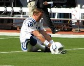 Peyton stretches before a game.