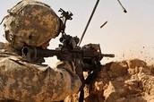 Soldier firing a standard M4A1 carbine.