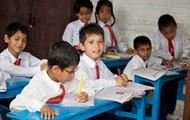 A group of school children.