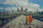 Two Monks approaching the Angkor Wat