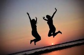 Two girls jumping in the air