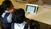 Class IV student watching Fraction Video on Tab