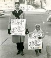 Mom and child boycotting segregation in public schools.