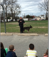 3rd Grade meeting Officer Wright and Rokko.