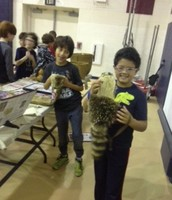 Caden and Diego with a raccoon pouch.