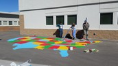 Teachers painting the US Map.