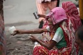 Poverty in india/What is being done about it around the world.