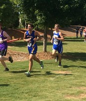 Brice Dodson running for the Varsity Cougars