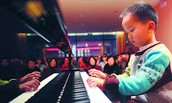 Little Kid That Knows To Play Piano At Small Age