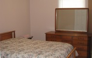 Furnished bedroom with two closets