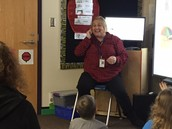 Ms. Trudy passionately leading her class in a read aloud