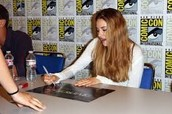 Shailene Woodley giving an autograph