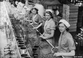 Women serving canned greens